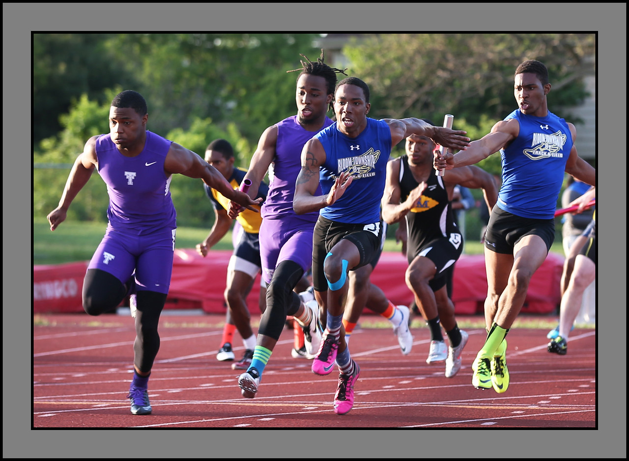 At the final exchange of the 4x100m relay Thornton's Jauan Wesley, left, pulls ahead of Bloom's Cedric Johnson. | Allen Cunningham/For Sun-Times Media