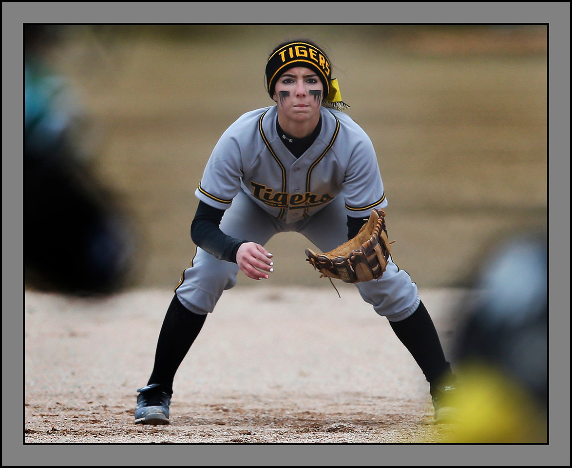 Joliet West's shortstop Kristine Bourg watches as the first pitch is delivered to a Plainfield Central batter. | Allen Cunningham~For Sun-Times Media