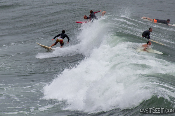 Sydney Harbour SurfingAs an East Coast Low brought a grey wet and windy day to Sydney, surfers ventured inside Sydney Harbour with waves well inside the heads creating good opportunities. It also brought the action closer to spectators braving the conditions.