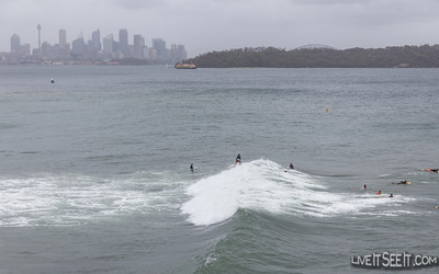 Sydney Harbour Surfing As an East Coast Low brought a grey wet and windy day to Sydney, surfers ventured inside Sydney Harbour with waves well inside the heads creating good opportunities.  It also brought the action closer to spectators braving the conditions.