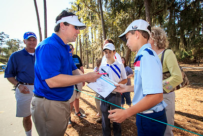 Coach Boom signing autographs on the course.