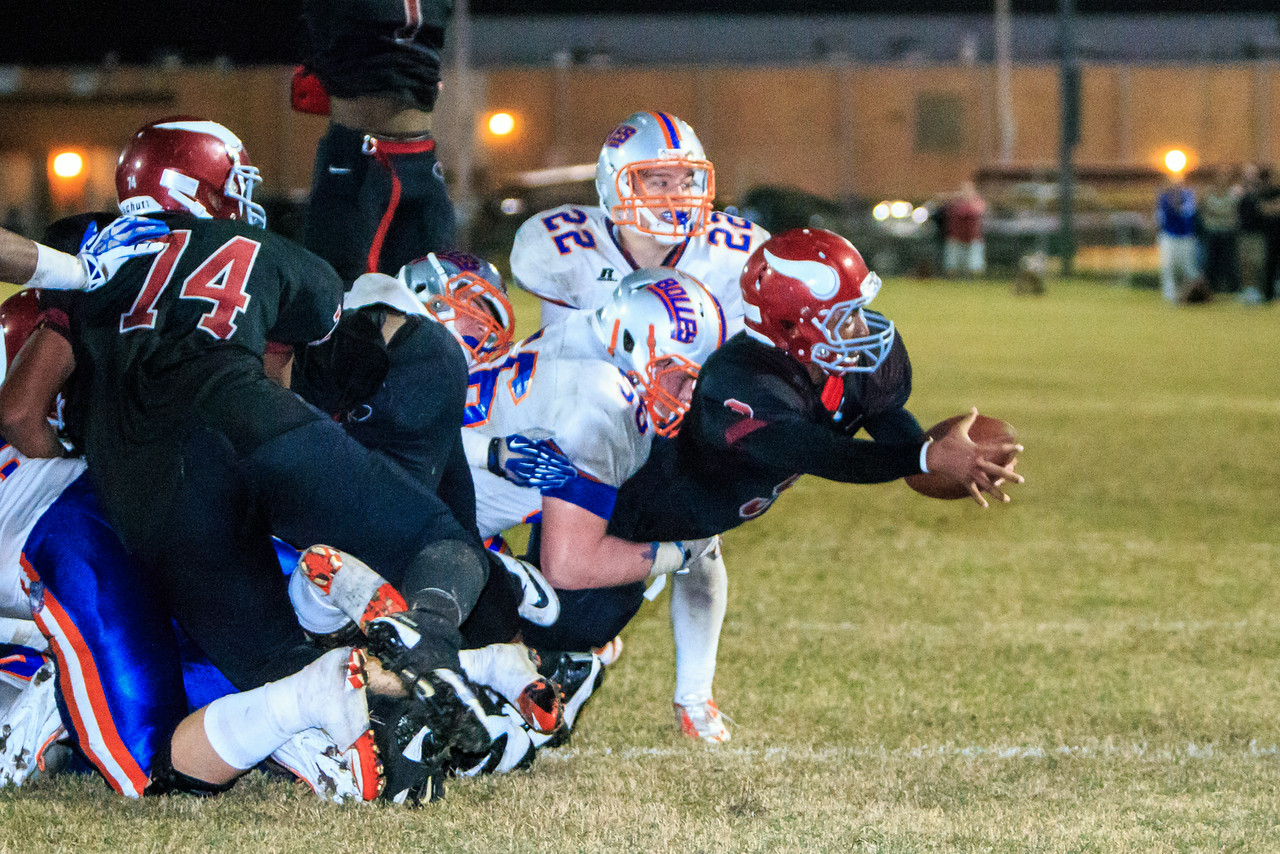 November 22, 2013: Raines' Marvin Zanders stretches to score the tying touchdown against Bolles in a state 4A quarterfinal at Raines High School.  Bolles would go on to win the game, 35-28 in two overtimes. -James Vernacotola