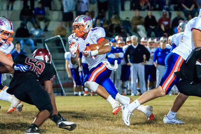 November 22, 2013: Bolles coach Corky Rogers watches as RB Christian Bermudez carries the ball to the 1 yard line to set up the winning touchdown in the second overtime of a state 4A quarterfinal vs. Raines at Raines High School. -James Vernacotola