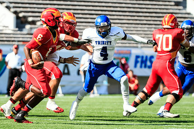 December 7, 2013: Trinity Christian Academy' Deontai Williams tries to tackle Jeff Smith during the Conquerors' State Championship victory over Clearwater Catholic Central at the Orlando Citrus Bowl. -James Vernacotola