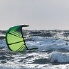 Kite in the sun with kitesurfer in the water