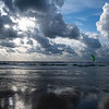 Kitesurfer and clouds reflections