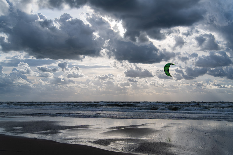 Kitesurfer and sky reflection