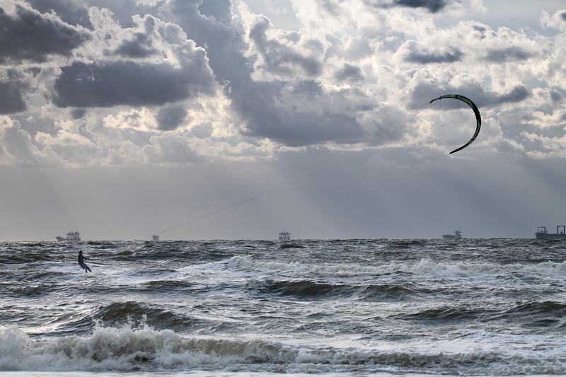 Kitesurfer and big ships