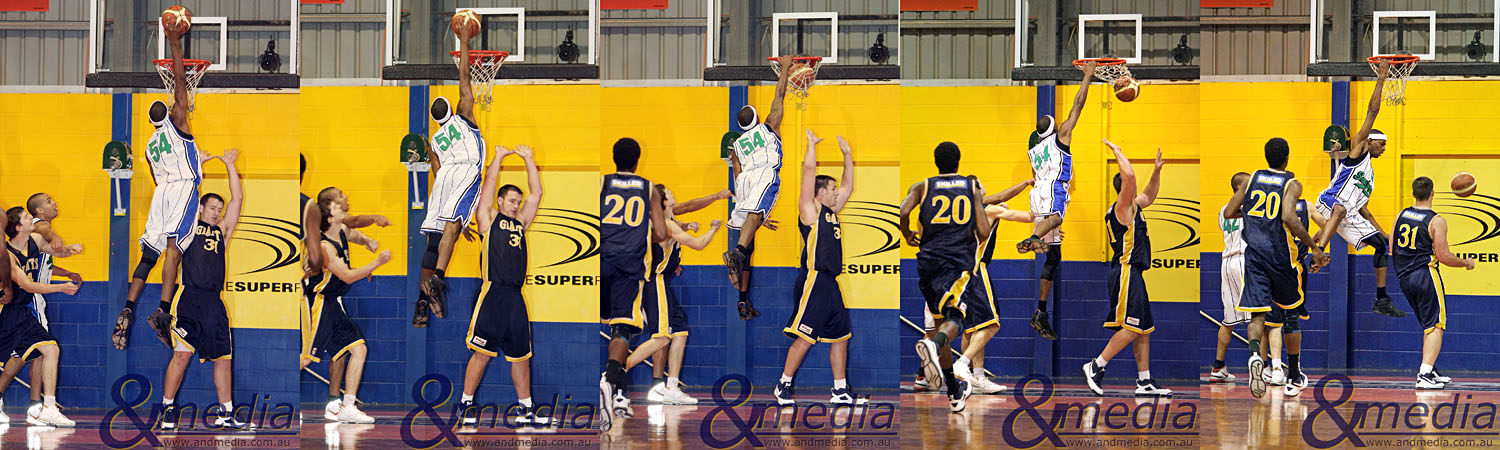 060609GGSS055758596063 SBL - Goldfields Giants vs Stirling Senators. Stirling import Edward Morris Jr. with this emphatic slam dunk over the Giants' Michael Haney. Photo by Travis Anderson - Andmedia/Sports Vision © 2009.