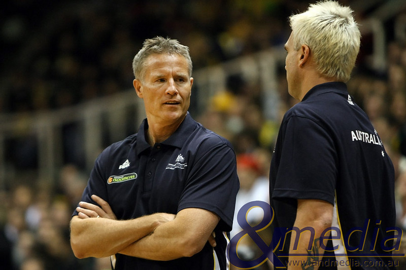 250610AUAR0711 FIBA Mens - Australia vs Argentina - 25th June 2010 Australian Boomers head coach Brett Brown talks with assistant Shane Heal during a break in play. Photo by Travis Anderson - Andmedia ©2010.