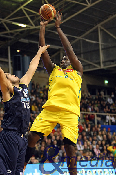250610AUAR0742 FIBA Mens - Australia vs Argentina - 25th June 2010 Australian centre Nathan Jawai shoots over Argentinian centre Diego Romero. Photo by Travis Anderson - Andmedia ©2010.
