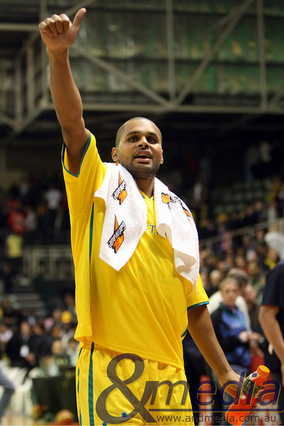 250610AUAR0998 FIBA Mens - Australia vs Argentina - 25th June 2010 Australian point guard Patrick Mills acknowledges the Perth crowd after the Boomers 97-58 defeat of Argentina. Photo by Travis Anderson - Andmedia ©2010.