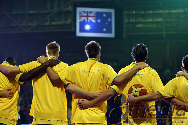 250610AUAR0012 FIBA Mens - Australia vs Argentina - 25th June 2010 Australian teamamtes Nathan Jawai, Luke Nevill, Ben Allen, Alex Loughton and Damian Martin during the Australian National Anthem. Photo by Travis Anderson - Andmedia ©2010.