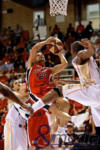 060311NBL10310 Perth Wildcats vs Cairns Taipans - 06/03/2011 Challenge Stadium Perth Wildcats guard Kevin Lisch is fouled hard on this layup attempt by Taipans' forward Ron Dorsey. Photo: TRAVIS ANDERSON - ANDMEDIA