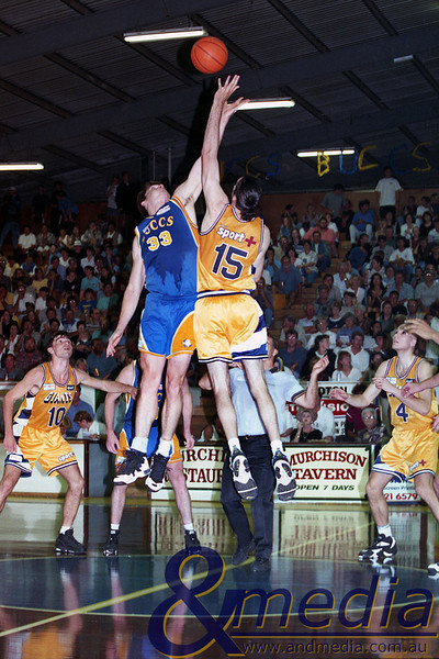 091196GBGG0135A SBL - Semi Final Game 2 - Goldfields Giants @ Geraldton Buccaneers - 9th November 1996 Buccaneers' centre Joe Regnier and Giants' centre Jason Harrison contest the 4th quarter tipoff. Photo by Travis Anderson - Andmedia/Pro Sports Images ©1996.