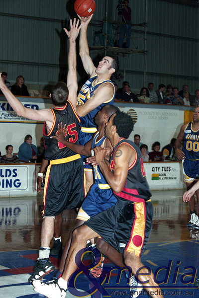 240597GGMM0121A SBL - Goldfields Giants vs Mandurah Magic - 24th May 1997 Giants' centre Jason Harrison shoots the hook shot over Magic centre Josh Lee as Giants' import Vern Robateau and Magic import Kamau Herndon jostle for position. Photo by Travis Anderson - Andmedia/Pro Sports Images ©1997.