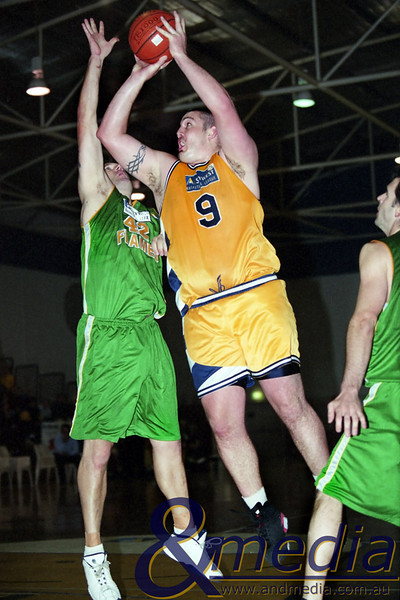 120501RFGG0104 SBL - Goldfields Giants @ Rockingham Flames - 12th May 2001 Giants' centre Jason Ring shoots over the outstretched arm of Flames' bigman Ricky Beet. Photo by Travis Anderson - Andmedia/Pro Sports Images ©2001.