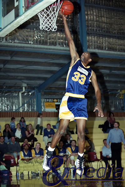 130501SSGG0124 SBL - Goldfields Giants @ Stirling Senators - 13th May 2001 Giants' swingman Calvin 'Doc' Earl glides in for the easy layup. Photo by Travis Anderson - Andmedia/Pro Sports Images ©2001.