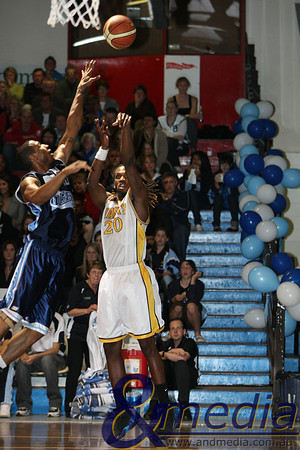 070908kalgiants22ta 2008 SBL Grand Final Goldfields Giants vs Willetton Tigers Giants import shoots a baseline jumpshot over the outstretched arm of Willetton import Robert Epps.