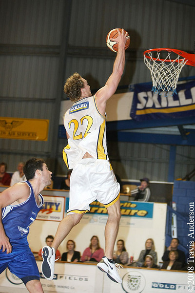 270708kalgiants2ta Goldfields Giants vs Perry Lakes Hawks SBL Basketball Mark Heron (Giants) glides in for the dunk as Jay Duncan (Hawks) looks on.