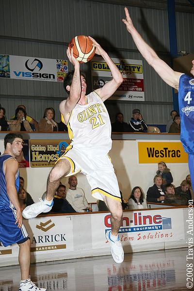 270708kalgiants1ta Goldfields Giants vs Perry Lakes Hawks SBL Basketball Giants captain Shamus Ballantyne shoots over Peter Crawford (Hawks)