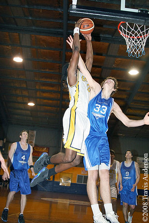 270708kalgiants5ta Goldfields Giants vs Perry Lakes Hawks SBL Basketball Darnell Dialls (Giants) is fouled hard on this dunk attempt by Ben Purser (Hawks)