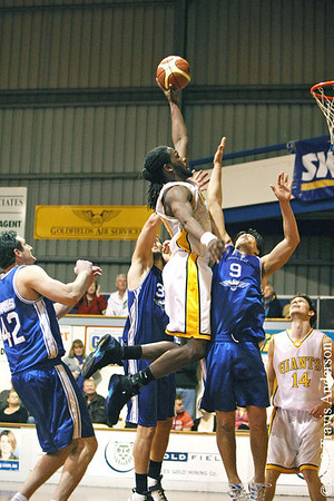 270708kalgiants4ta Goldfields Giants vs Perry Lakes Hawks SBL Basketball Darnell Dialls (Giants) attempts this massive tip-in dunk off a rebound over Jo-Alan Tupaea (Hawks 9) and Sean Sonderleiter (Hawks 32).