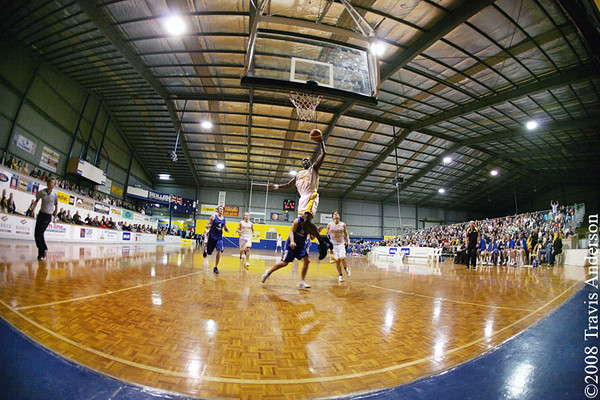 270708kalgiants6ta Goldfields Giants vs Perry Lakes Hawks SBL Basketball Darnell Dialls swoops in for the dunk in the final seconds of the 2nd quarter to give the Giants a 58-44 lead. Photo was taken with a fisheye lens which provides a 180 degree view.