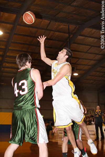 280608kalgiants4ta SBL Basketball - Goldfields Giants vs Wanneroo Wolves. Todd Earle (Giants) throws up this desperation shot over Greg Hire (Wolves) to beat the shot clock.