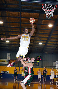 2008 Giants' import Darnell Dialls gets some serious hangtime on this dunk attempt over Wolves' player Matt Schmechtig during the 2nd quarter of their SBL clash.