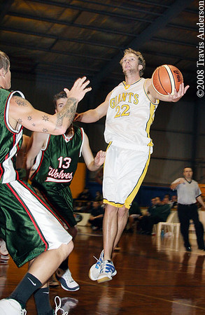 280608kalgiants1ta SBL Basketball - Goldfields Giants vs Wanneroo Wolves. Mark Heron (Giants) is forced to use his left hand for the shot on goal after being fouled by Brad Hawkins (Wolves 13).