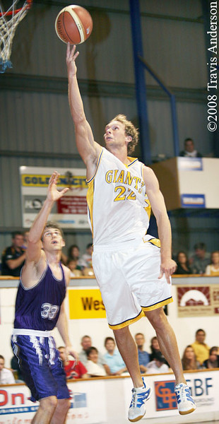 Mark Heron lays the ball up over Lakeside import Christian Moody.