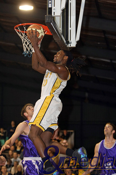 300809GGLLK1951 SBL - Goldfields Giants vs Lakeside Lightning - Semi Finals Game 2 Giants' import Darnell Dialls almost hits his head on the backboard on this reverse layup over Lakeside import Cristian Moody. Photo by Travis Anderson