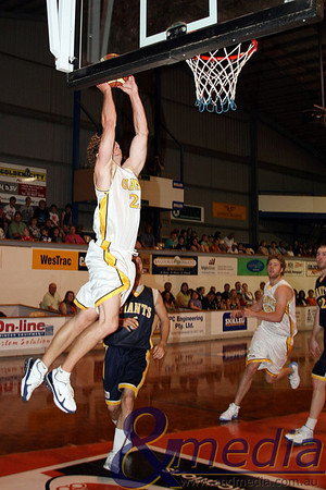 071109GGASK3652 SBL - Goldfields Giants vs SBL Allstar Select Team. Giants' forward Mark Heron gets upstairs over the top of former Rockingham Flames guard Carlin Hughes. Photo by Travis Anderson - Andmedia/Sports Vision ©2009.