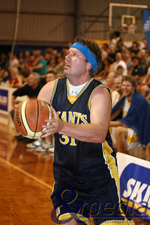 071109GGASK3980 SBL - Goldfields Giants vs SBL Allstar Select Team. Former Perth Wildcat Aaron Trahair hamming it up for the crowd with a beer promo headband which left the Giants bench in hysterics. Photo by Travis Anderson - Andmedia/Sports Vision ©2009.