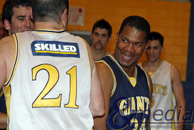 071109GGASK4115 SBL - Goldfields Giants vs SBL Allstar Select Team. Former Giants' player Marcus Taylor (21) and former Perth Wildcat Ricky Grace share a joke after the game. Photo by Travis Anderson - Andmedia/Sports Vision ©2009.