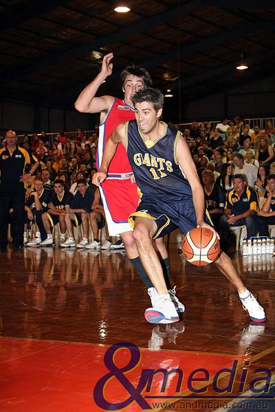 050409kalgiants1ta SBL - Goldfields Giants vs Bunbury Slammers Todd Earle drives to the basket against his Bunbury opponent Nat Fielding.
