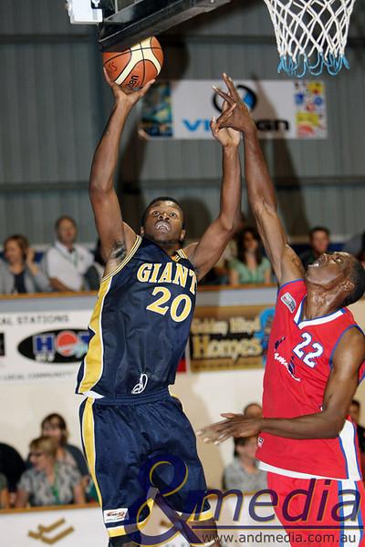 050409kalgiantsta SBL - Goldfields Giants vs Bunbury Slammers Goldfields Giants import Alonzo Hird shoots over Bunbury Slammers import John Smith.