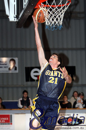 180709GGWTK5719 SBL - Goldfields Giants vs Willetton Tigers Giants' guard Shamus Ballantyne completes the uncontested layup. Photo by Travis Anderson
