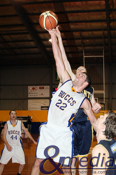 040709GGGBK8987 SBL - Goldfields Giants vs Geraldton Buccaneers Geraldton import Luke Meyer and the Giants' Russell Hurst contest for the rebound. Photo by Travis Anderson
