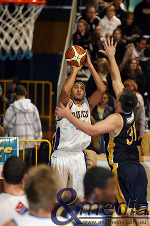 040709GGGBK8720 SBL - Goldfields Giants vs Geraldton Buccaneers Geraldton import Michael Le Blanc shoots the long range jumpshot over the Giants' import Michael Haney. Photo by Travis Anderson