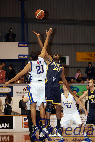 040709GGGBK8475 SBL - Goldfields Giants vs Geraldton Buccaneers Giants' import Alonzo Hird and Geraldton import Michael Le Blanc contest the jump ball at the start of the game. Photo by Travis Anderson
