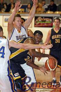 040709GGGBK8900 SBL - Goldfields Giants vs Geraldton Buccaneers Giants' import Alonzo Hird passes the ball out from the double team formed by Geraldton's Tom Witts and Matt Wundenberg. Photo by Travis Anderson