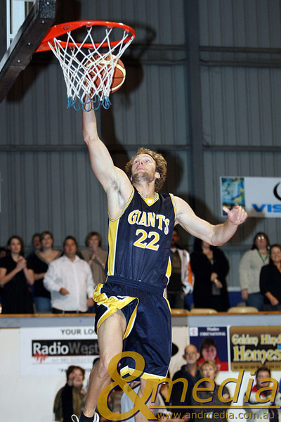 060609GGSS0460 SBL - Goldfields Giants vs Stirling Senators Giants' swingman Mark Heron goes up for the dunk to open the scoring for the Giants. Photo by Travis Anderson - Andmedia/Sports Vision © 2009.