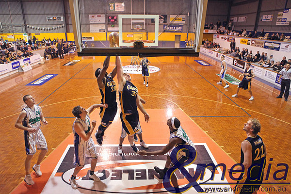060609GGSS9477 SBL - Goldfields Giants vs Stirling Senators. Giants duo Alonzo Hird and Michael Haney contest for the rebound over the Senators' Warwick Bird and Edward Morris Jr. Photo by Travis Anderson - Andmedia/Sports Vision © 2009.