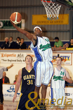 060609GGSS1062 SBL - Goldfields Giants vs Stirling Senators. Stirling import Edward Morris Jr hauls in the defensive rebound ahead of the Giants' Michael Haney. Photo by Travis Anderson - Andmedia/Sports Vision © 2009.