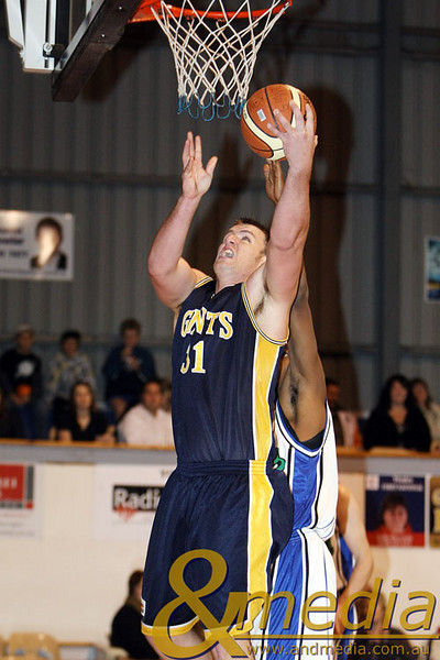 060609GGSS0476 SBL - Goldfields Giants vs Stirling Senators Giants' import Michael Haney attempts the reverse layup over Stirling import Edward Morris Jr. Photo by Travis Anderson - Andmedia/Sports Vision © 2009.