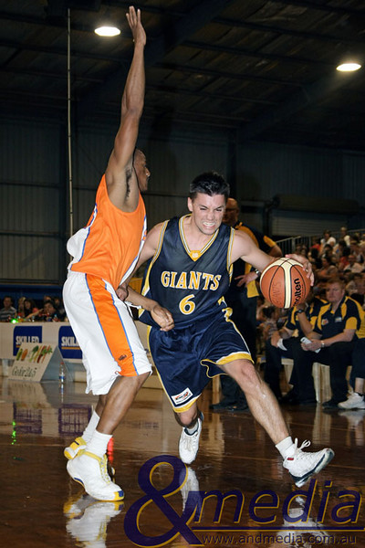 280309kalgiants1ta SBL - Goldfields Giants vs Eastern Suns Jimmy Bowler (Giants) drives to the hoop against Adebayo Oladejo (Suns). Photo: Travis Anderson