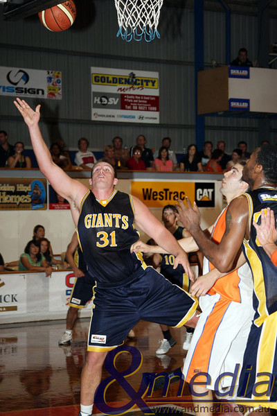 280309kalgiants4ta SBL - Goldfields Giants vs Eastern Suns Michael Haney (Giants) scores on this acrobatic layup. Photo: Travis Anderson