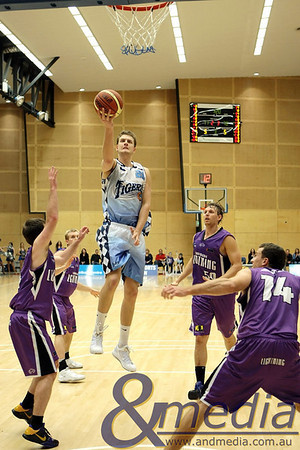 220810kalsbl1supp SBL Mens Grand Final - Lakeside Lightning vs Willetton Tigers - 21st August 2010 Tigers' centre Daniel Johnson goes up for the layup over Lightning duo Steven Butler (front left) and Jarrad Prue (14). Photo by Travis Anderson - Andmedia ©2010.